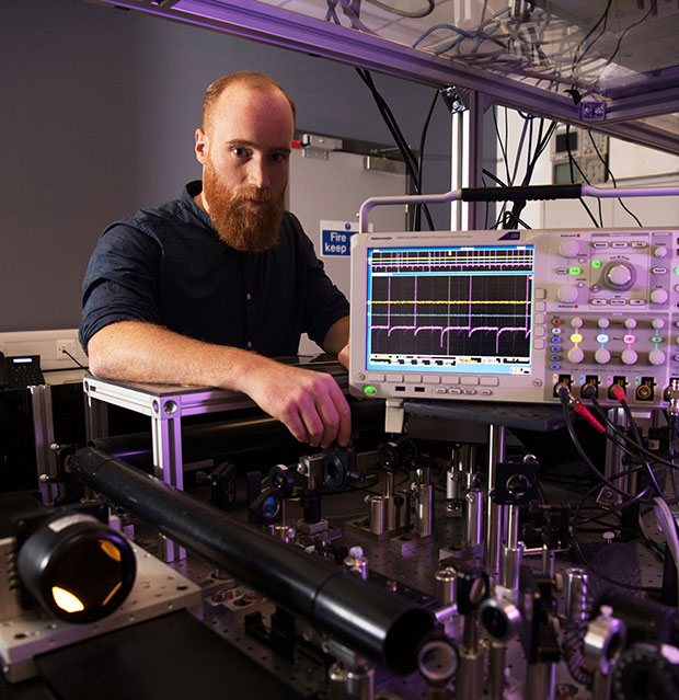 Mario González Jiménez operating the femtosecond laser amplifier
